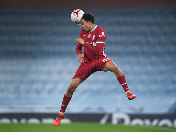 MANCHESTER, ENGLAND - NOVEMBER 08: Trent Alexander-Arnold of Liverpool heads the ball during the Premier League match between Manchester City and Liverpool at the Etihad Stadium on November 8, 2020 in Manchester, United Kingdom. Sporting stadiums around the UK remain under strict restrictions due to the Coronavirus Pandemic as Government social distancing laws prohibit fans inside venues resulting in games being played behind closed doors. (Photo by Visionhaus)