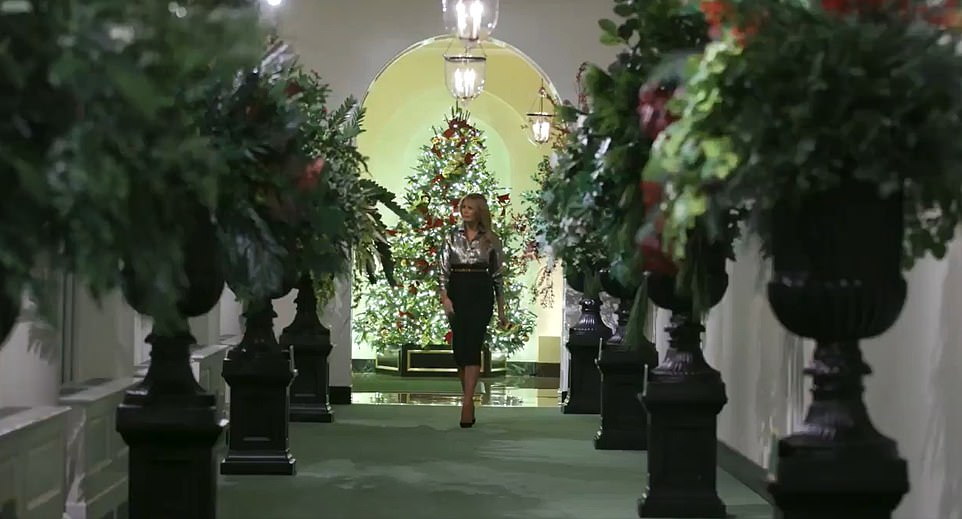 Melania struts through Christmas trees in the White House after THAT secret recording