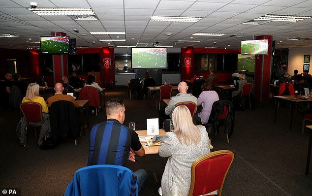 Middlesbrough fans gather in lounges at the Riverside Stadium to watch Nottingham Forest game on TV