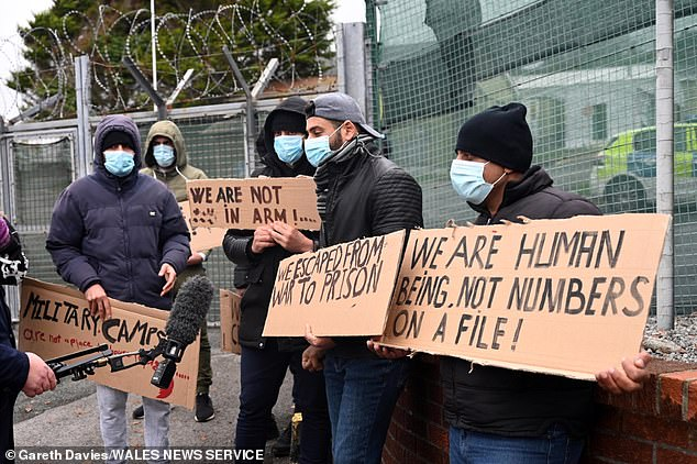 Migrants protest over conditions at ex-military base in Wales