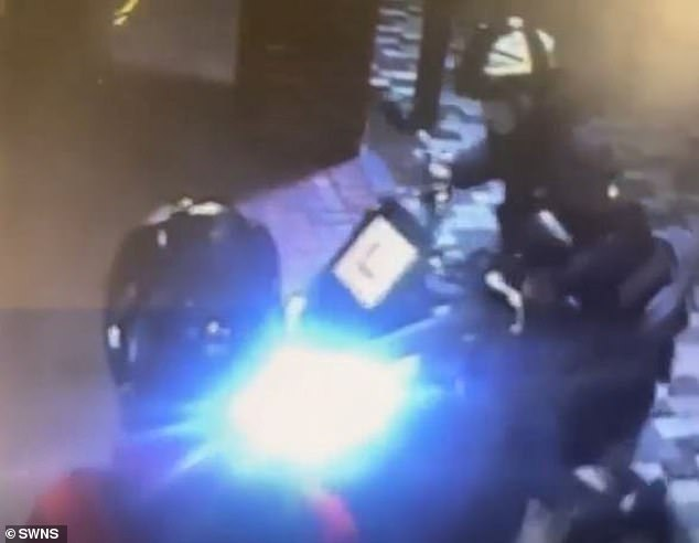 Moment burglars use stolen scooter with L plates to smash their way into beauty salon