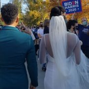 Moment newlyweds are cheered on by crowds minutes after Biden was declared winner