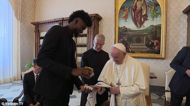 Orlando Magic forward Jonathan Isaac shares a jersey and other keepsakes with Pope Francis