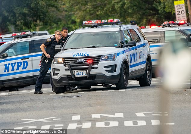 NYC man, 20, is shot dead in broad daylight as NYPD reveals shootings have DOUBLED in the past year