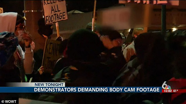 Omaha demonstrators refuse to disperse as they protest the police shooting of Kenneth Jones