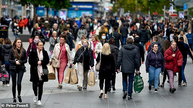 Only 26 shopping days left before Christmas! Shoppers flock to England's high streets to stock up
