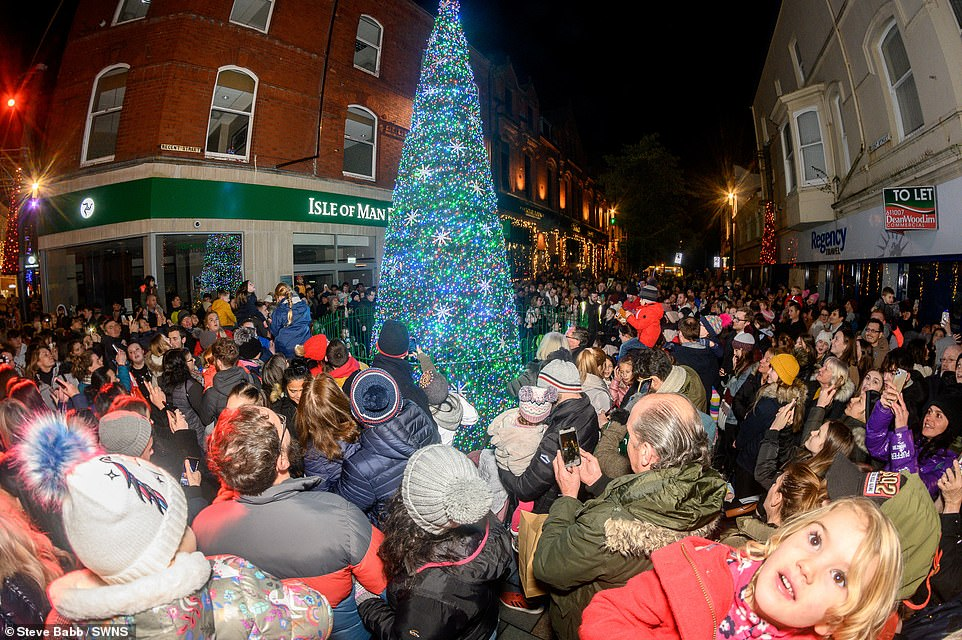 Only place in Britain where Christmas is going ahead as normal! Isle of Man holds festive switch on