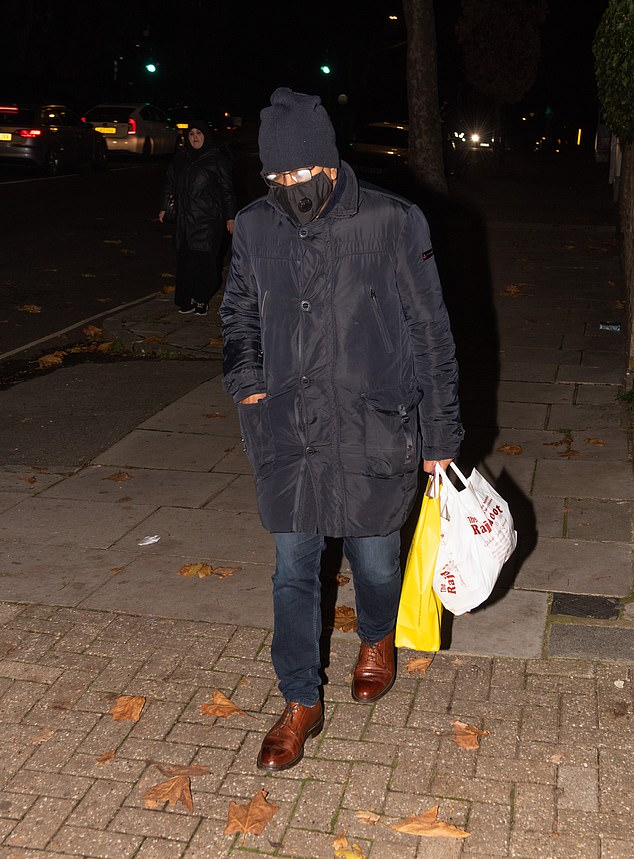 Panorama reporter Martin Bashir strolls out for a takeaway