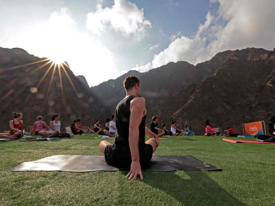 Photos: Health enthusiasts do Yoga at picturesque Hatta