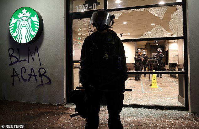 Protesters in Portland smash windows and try to set Starbucks on fire in election eve demonstrations
