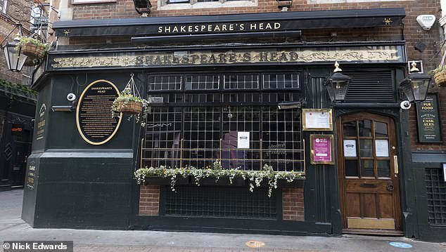 Dozens of pub landlords are celebrating a last-minute reprieve today as major breweries have slashed rents during the winter lockdown (pictured: a closed pub in London's West End today)