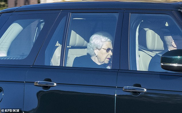 Queen is sombre in black as she leaves Windsor Castle by car