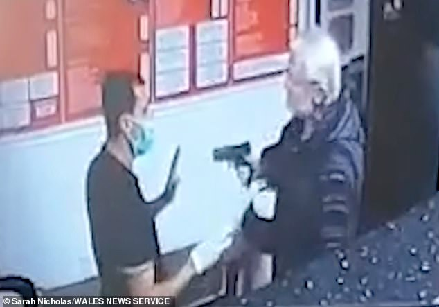 Raging kebab shop customer pulls out a 'GUN' after being told to wear a face mask in Welsh takeaway