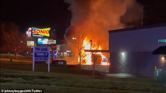 A SWAT team has surrounded a Sonic restaurant in Nebraska after reports of an 'active shooter' as flames engulfed a vehicle outside