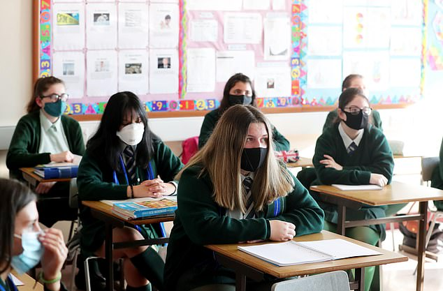 Secondary school pupils in England could be required to wear masks as they move between classrooms, like pupils in Scotland are currently required to do (Pictured: file photo of pupils in Northern Ireland)