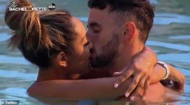 Tayshia Adams passionately kisses hunky contestant in the pool
