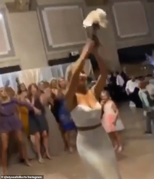 Wisconsin volleyball ace athletically catches bridal bouquet [Video]