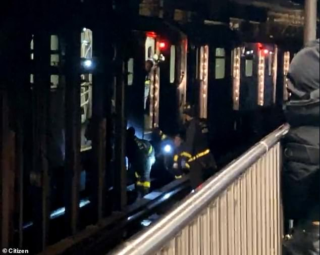 Woman is struck by a train after being pushed onto the tracks at an NYC subway station