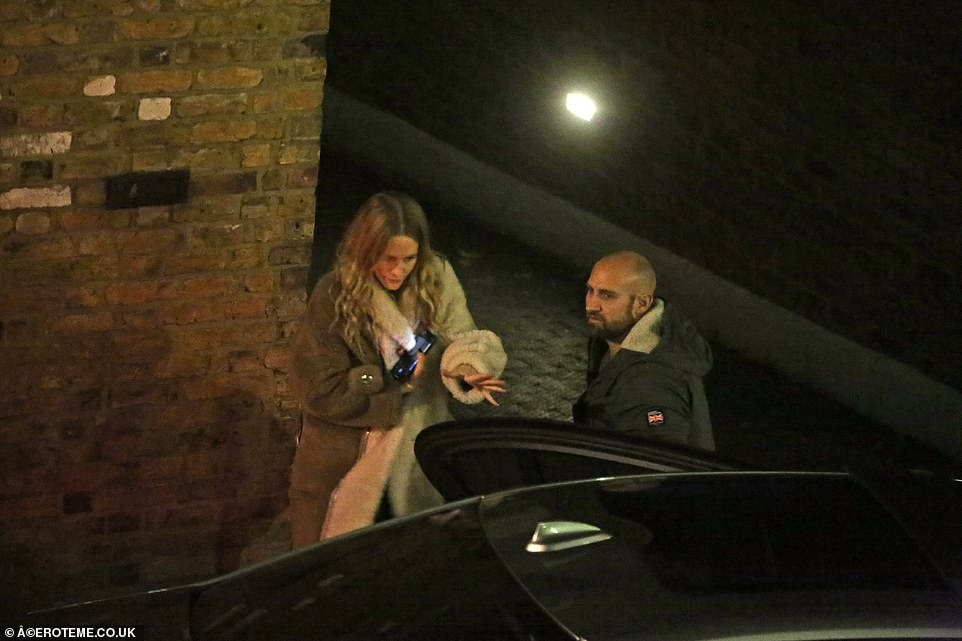 Poppy Delevigne grabs for her car door after enjoying a night celebrating with her sister and Miss Ora