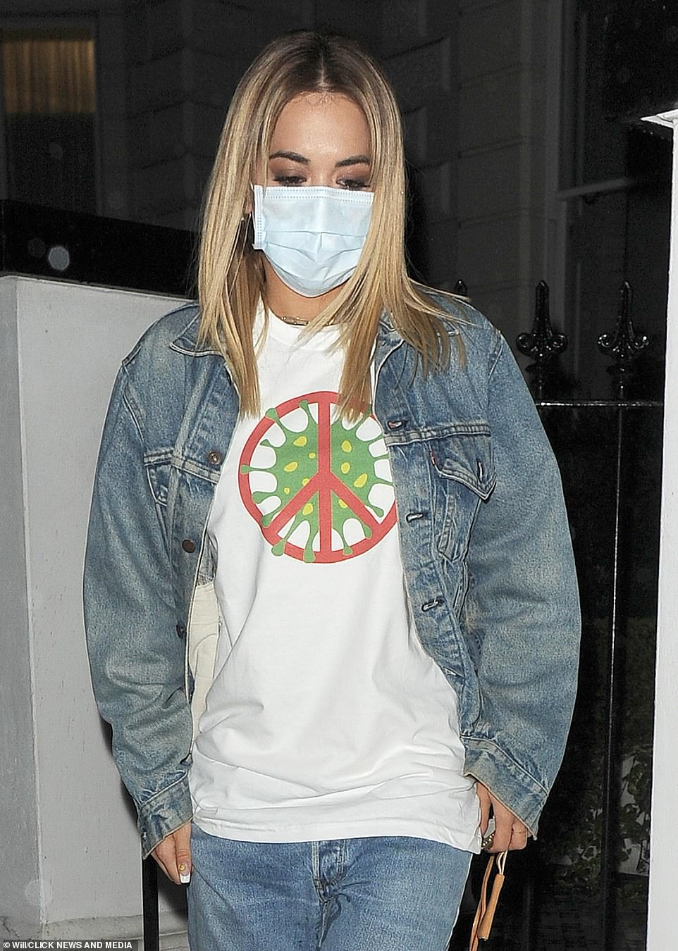 Ora urged people to 'stop the spread' of coronavirus when she stepped out wearing a self-designed motif T-shirt in March