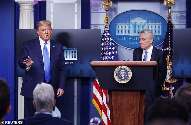 In his resignation letter obtained by Fox News, Atlas (pictured with Trump in September) said he worked hard to 'save the lives and help Americans through this pandemic'.
