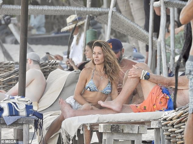 Just the two of us: The 49-year-old actress showcased her trim waistline while perched on a chair overlooking the beach in the trendy locale of Tulum