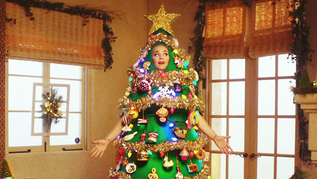 Katy Perry Dresses Up As A Christmas Tree & Rides On Top Of A Car During 'Disney Holiday Singalong'