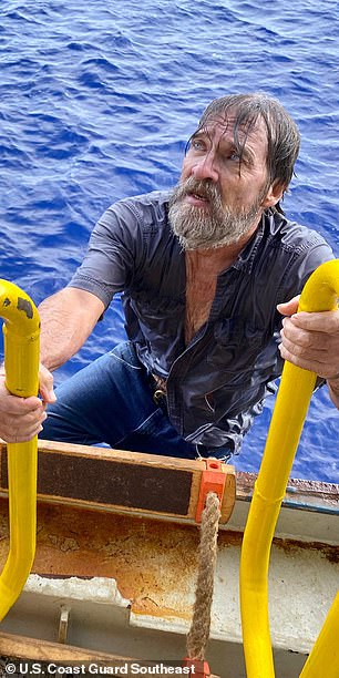 Stuart Bee, 62, climbs aboard the Angeles container ship after being found 86 miles from shore