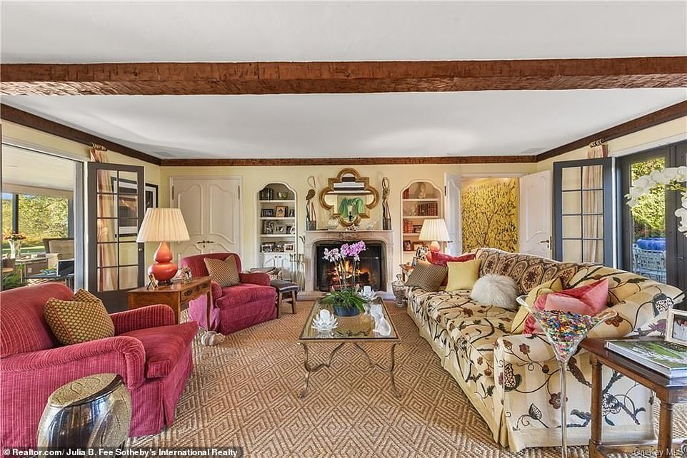 The spacious two-story home offers luscious views of the surrounding greenery in Westchester County