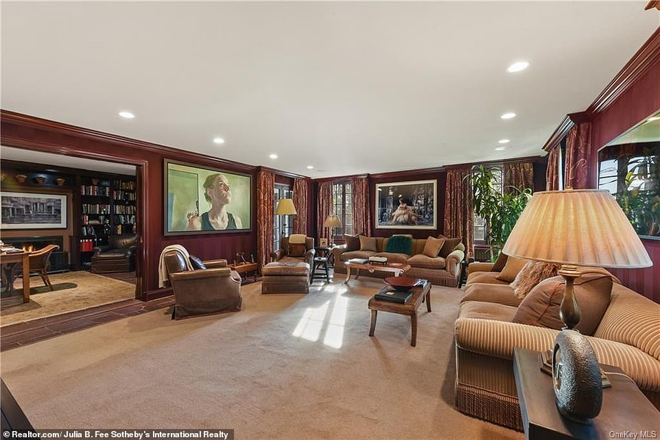 The centerpiece of the ground floor is a massive family room that contains works of art and fine furniture