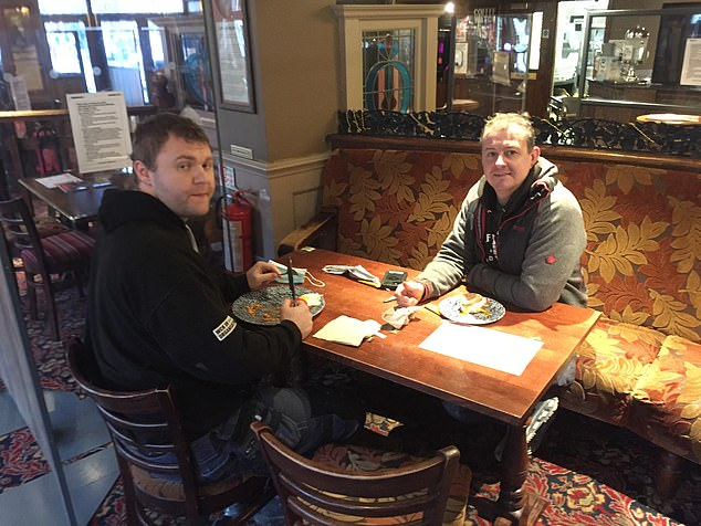 Pub-goers enjoy a breakfast at a Wetherspoon pub in London today after the new Tier 2 rules were introduced