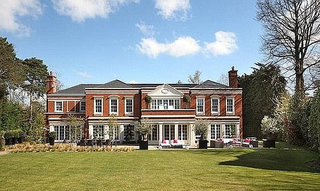 Akhmedova was handed ownership of the couple's £20m Surrey home (pictured) and an art collection worth more than £30m [File photo]