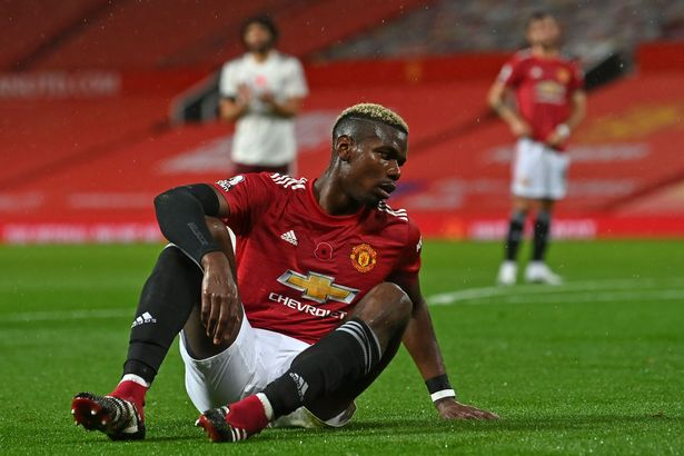 Paul Pogba reacts after giving away a penalty against Arsenal. (Photo by PAUL ELLIS/POOL/AFP via Getty Images)