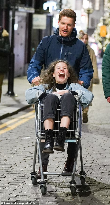 One student was seen pushing another student in a shopping trolley through the streets of Liverpool last night