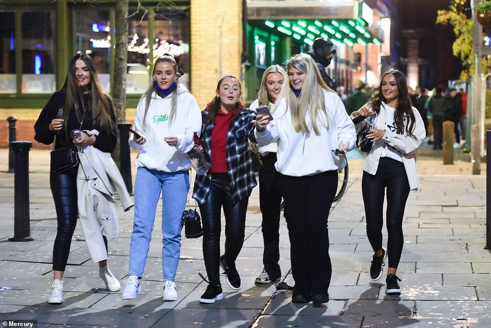 Punters will not be allowed to bring their own food into a pub - pouring cold water on plans to use food delivery services such as Deliveroo. Pictured: Revellers in Liverpool city centre on Wednesday