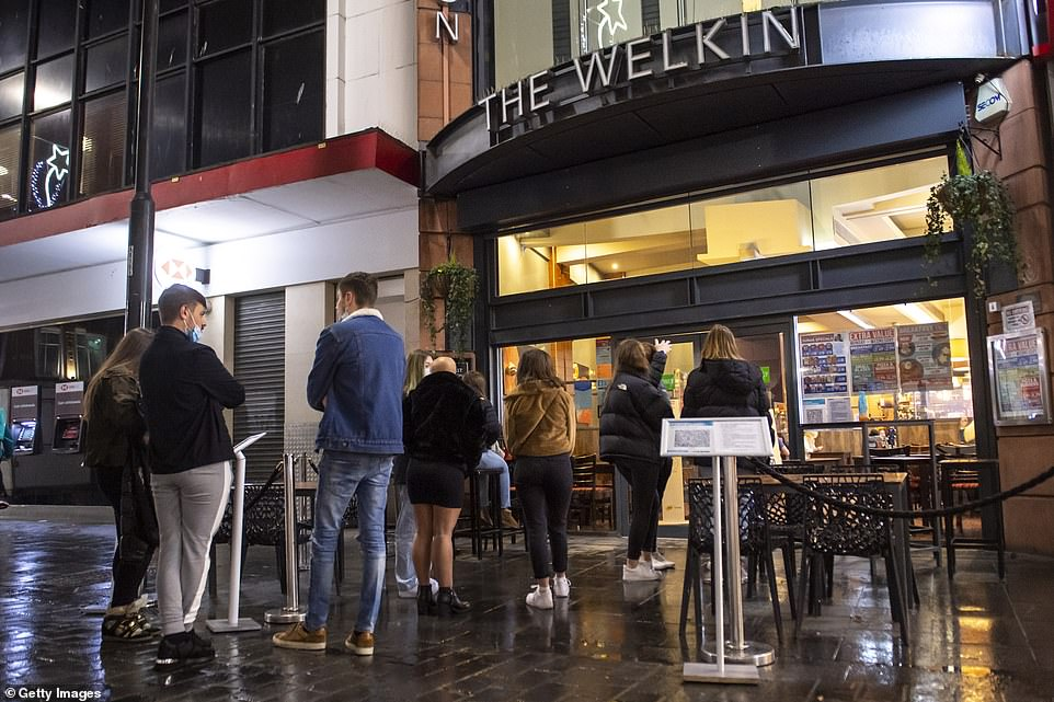 People queue to enter The Welkin bar in the city centre as Liverpool enters Tier 2. The city had been in Tier 3 before the lockdown started