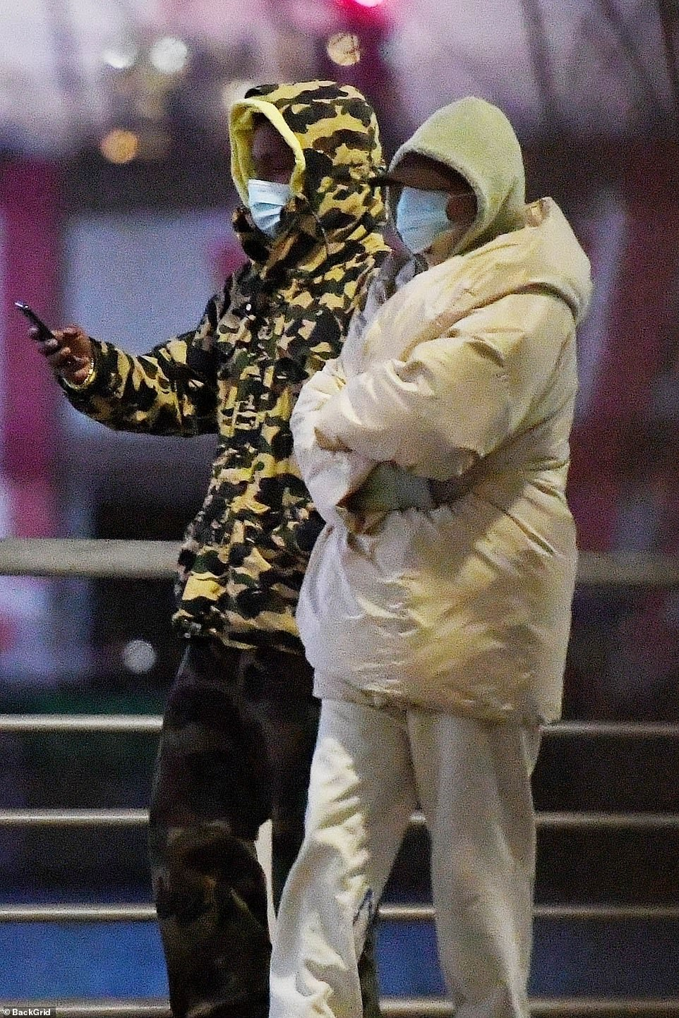 White on! Rihanna went with a magical monochome look, with the Umbrella songstress decking herself out in white sweatpants, white shoes and an enormous cream-colored jacket