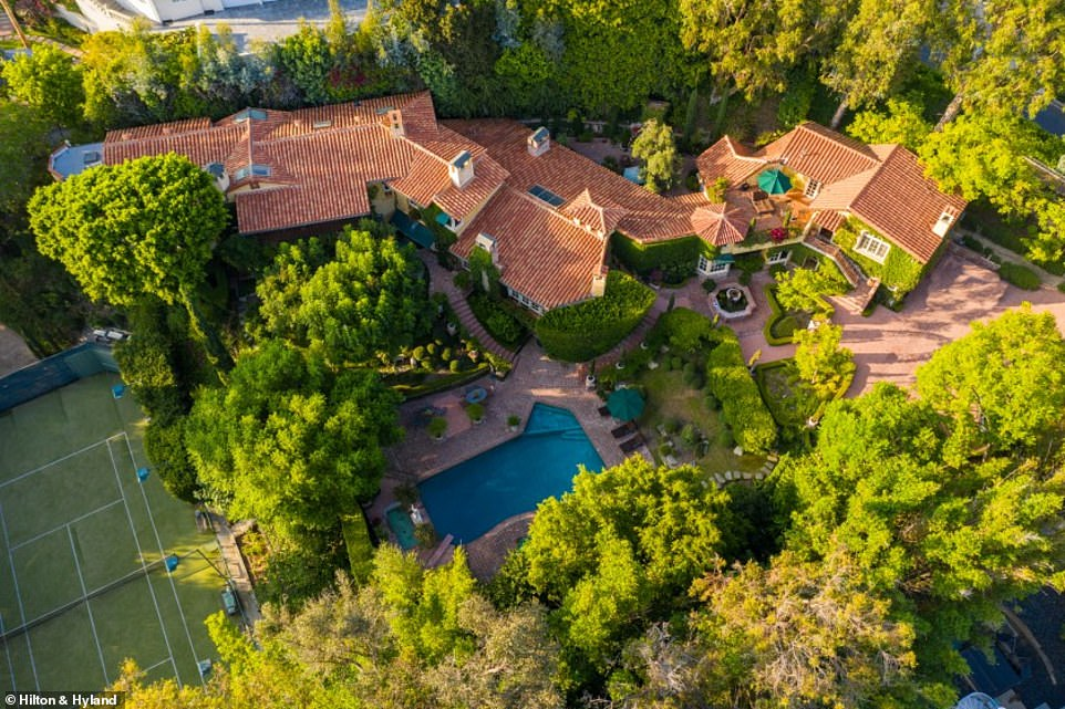Built in 1951, the estate listed on Hilton Hyland boasts seven bedrooms, eight-and-a-half bathrooms, a tile-lined swimming pool and tennis court