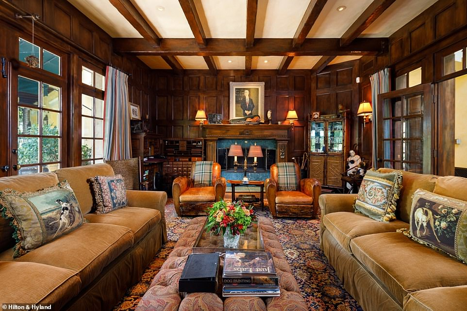Dark wood runs through the home, also featured in window panes, sculpted pillars throughout and panelling in the library/den combination room