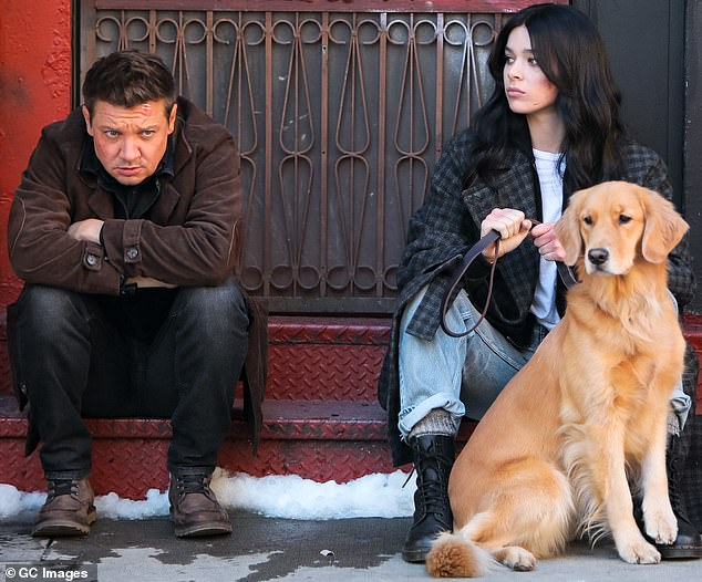 City that never sleeps: Their latest shoot day also took them to Chinatown where Jeremy could be seen looking sullen in character as he sat on a stoop beside Hailee