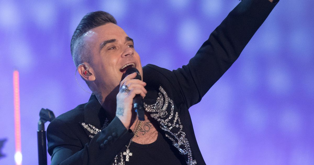 Robbie Williams 'forming new band for raves' 25 years after quitting Take That