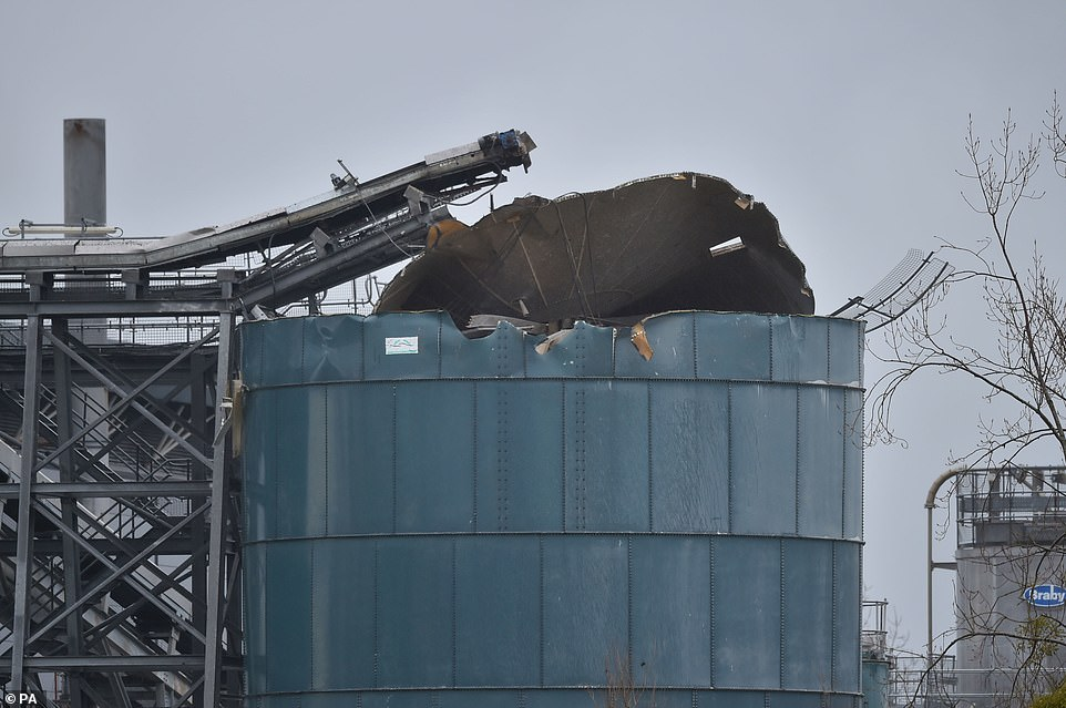 Pictured: The damage to the chemical tank at the Wessex Water sewage treatment plant where four people have died