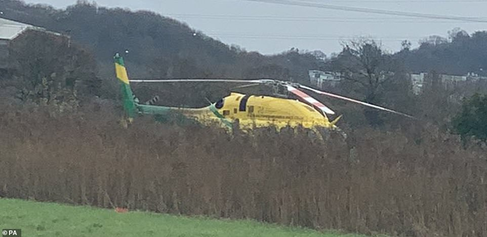A witness said earlier there was a 'helicopter looking for missing people' and police had closed a nearby road leading up to the building