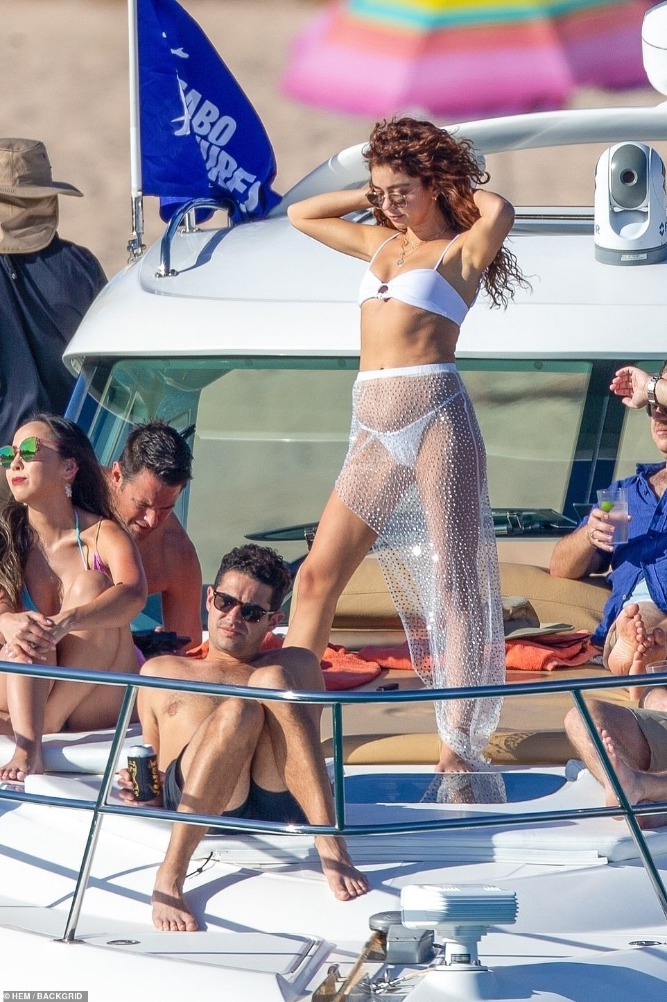Here comes the bride! Hyland gave off major bridal vibes in her white bikini with matching sheer sarong