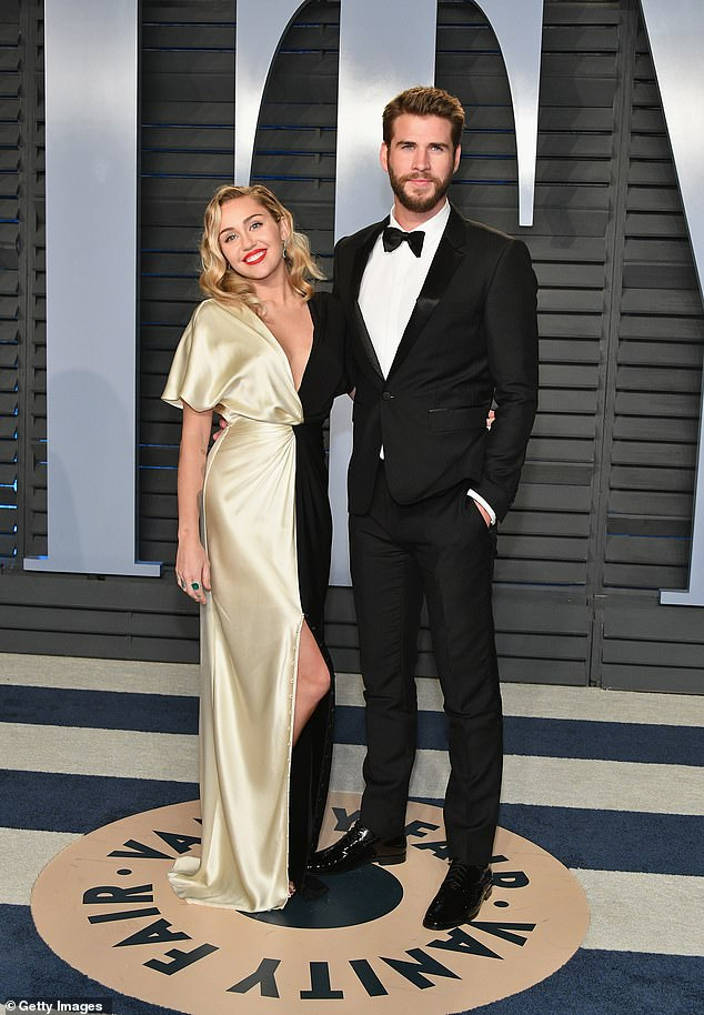 A tough time: 'A couple of years ago, it looked like I was living some fairy tale. It really wasn't. At that time, my experimentation with drugs and booze and the circle of people around me was not fulfilling or sustainable or ever going to get me to my fullest potential and purpose,' she said; seen with Liam Hemsworth in 2018