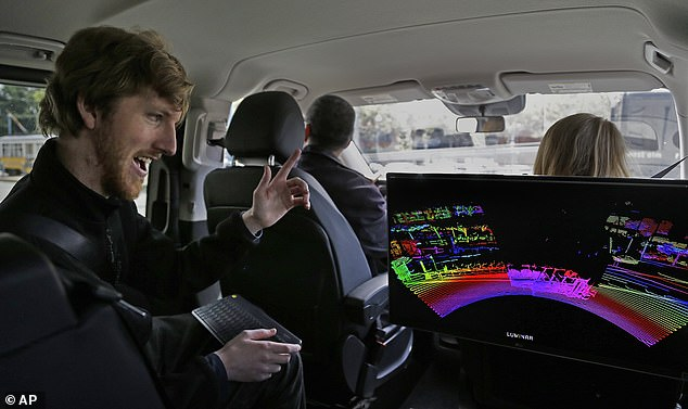 Russell shows off the 3-D map created by his company's lidar sensor, which self-driving cars can use to detect and navigate their surroundings