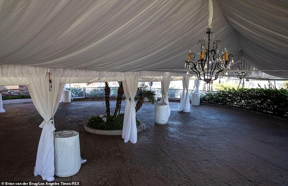 Chandeliers hangs above a space where outdoor dining had been set up at Flemings Prime Steakhouse in Woodland Hills