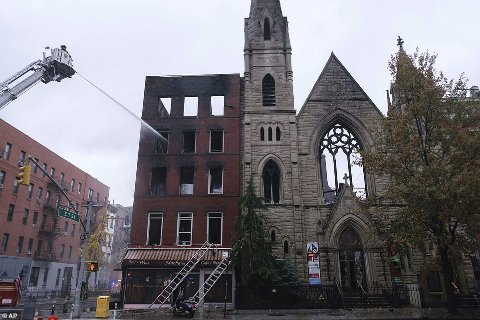 The blaze began inside a vacant five-story building on East 7th Street (left) before flames spread to the neighboring house of worship, which was built back in 1891