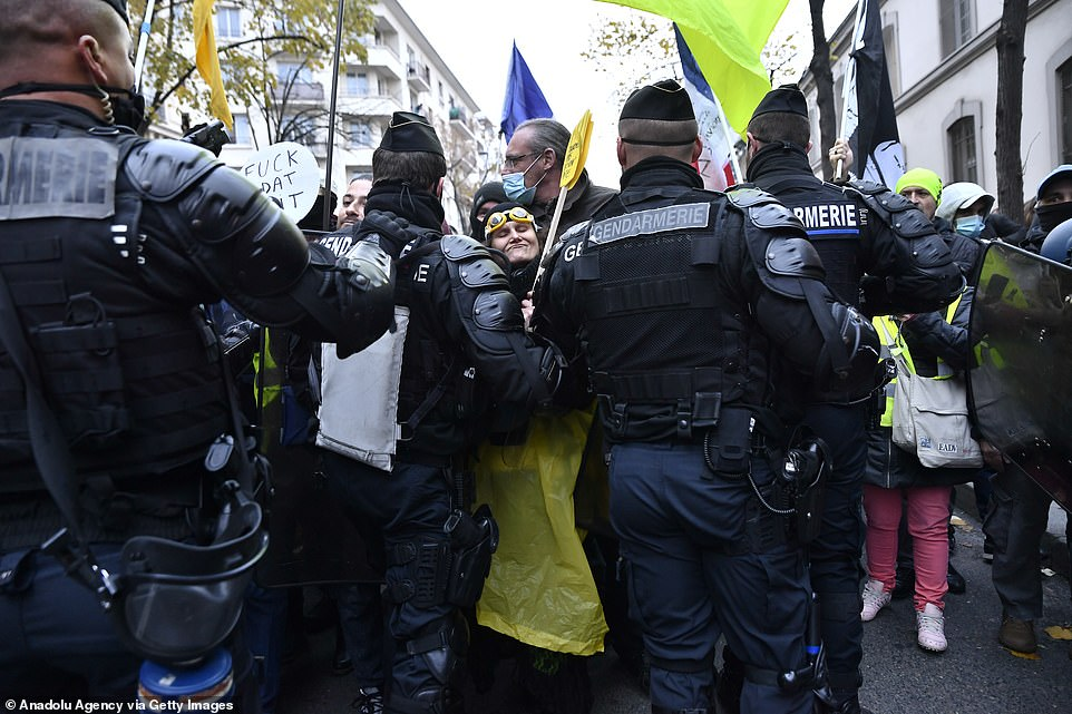 Demonstrators attempted get past the wall of riot police who blocked the street in Paris which saw fires and clashes break out in the capital
