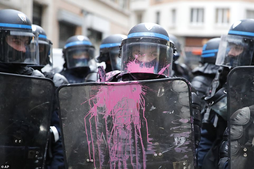 During the struggle between officers and demonstrators in Paris, the police were pelted with pink paint as well as claims of other missiles being launched at them